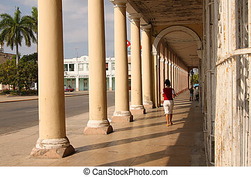 People under arches in Cuba - People waking under...