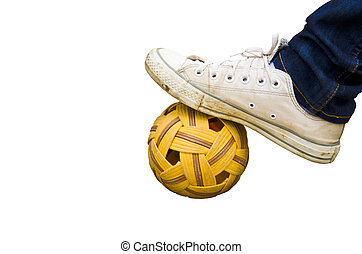 foot and old shoes on Rattan ball , asia favorite sports