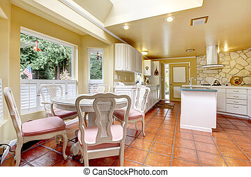 Ivory and white kitchen room with dining table set