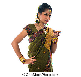 indian female in traditional clothes with lamp