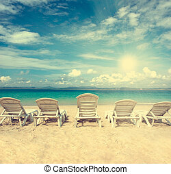 chairs on beach with blue sky for summer holiday vintage...
