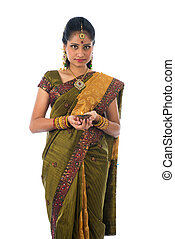 indian woman in traditional clothes with lamp