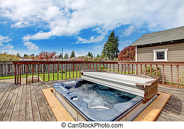 Backyard deck with jacuzzi - Backyard wooden deck with...