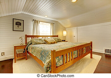 Wood plank paneled bedroom with vaulited ceiling and...