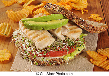 Grilled chicken and sprouts sandwich - A grilled chicken...