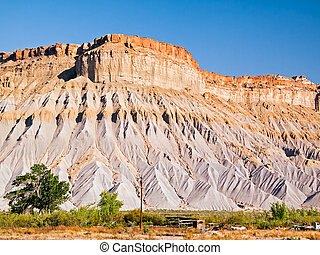 Utah Badlands - Sandstone mesas with Mancos shale are found...