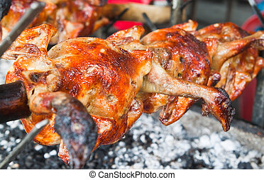 Fresh barbecue chicken on open grill