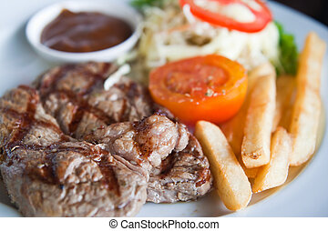 juicy steak beef meat with tomato and potatoes