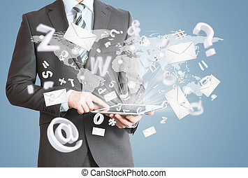 Man in suit holding tablet pc. Mailing concept - Man in suit...