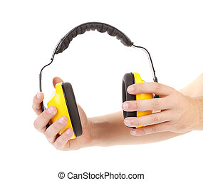 Ear protectors in human hand. On a white background.