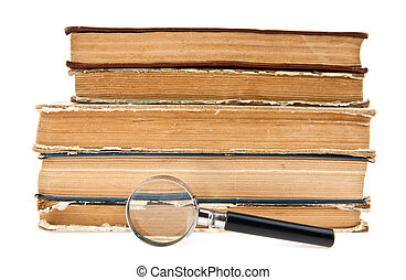 old books and magnifying glass