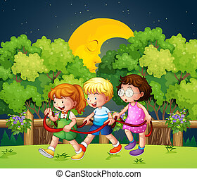 Three kids outdoor walking in the middle of the night -...