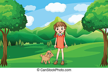 A young girl and her puppy at the hill