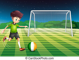 A soccer player kicking the ball with the flag of Ireland