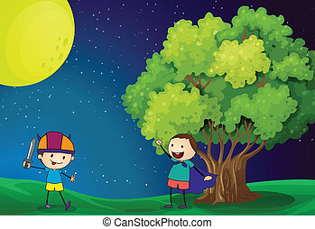 Happy kids playing near the tree under the bright fullmoon -...
