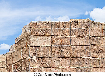 Concrete block wall with blue sky