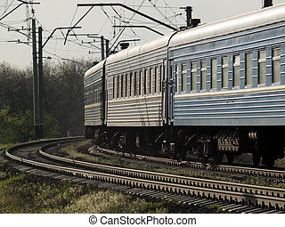 Train on curve - Ukrainian passenger train on curve close-up...
