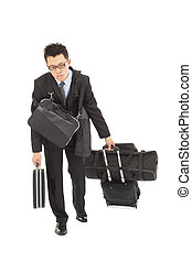 exhausted businessman taking all bags and suitcases -...