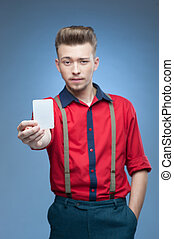 young retro man holding empty card over blue background