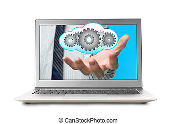 Hand out front laptop screen with cloud and gears inside...