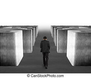 Man walking through 3d concrete maze with fog in front