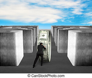 Man pushing money circle through 3d Maze with blue sky...