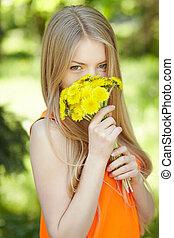 Girl smelling bunch of dandelions - Spring girl Lovely blond...