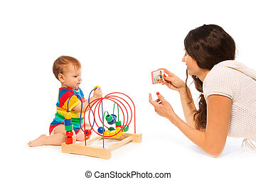 Photograph baby playing - Mother photograph her little...