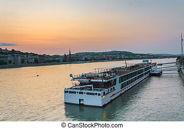 The ship sails on the Danube in Budapest at night