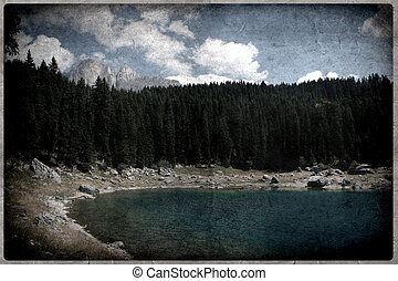 Carezza Alpine Lake in the Dolomites Mountains - Carezza...
