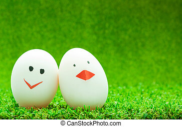 Couple eggs on green background