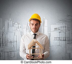 Architect with building project