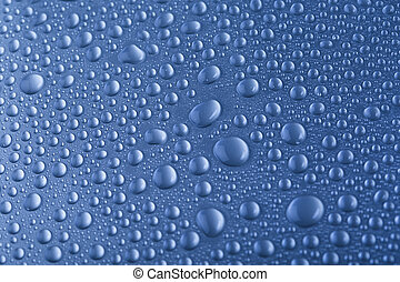 Drops of water on blue background - Drops of water on dark...