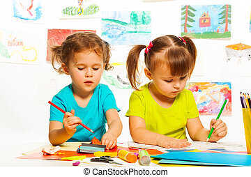 Girls in kindergarten lesson - Two little girls painting on...
