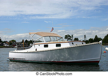 Cabin Cruiser - A classic cabin cruiser moored in a harbor...