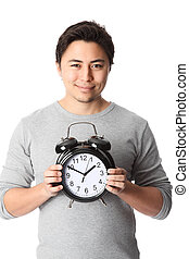 Time is valuable! - Young attractive man holding a clock....