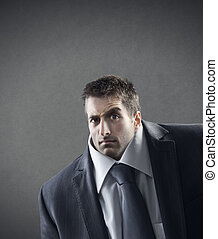 Confused businessman - Young businessman with raised eyebrow...