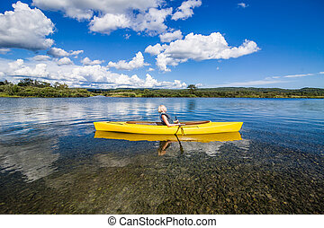 Calm River and Woman relaxing in a Kayak - Calm River and...