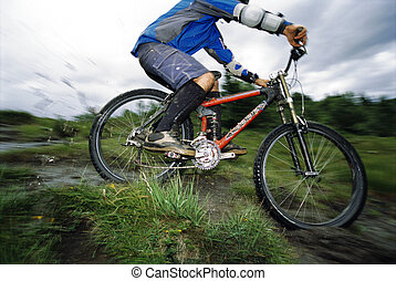 Young man mountain biking
