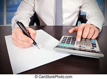 accountant working with calculator and paper in the office