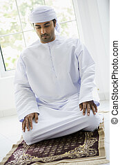 A Middle Eastern man praying