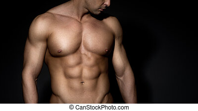 Bare chested muscle man - Bare chested muscular man looking...
