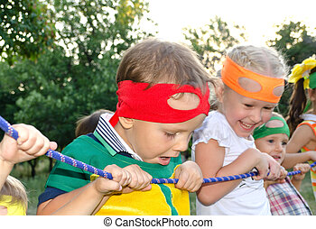Young boy enjoying a tug of war at a party
