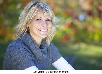 Woman smiling at the camera outside