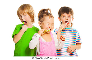 Three kids brushing teeth - Close shoot of three happy...