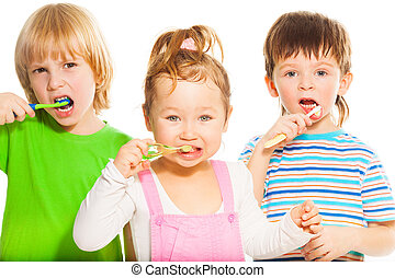 Three little brushing their teeth - Three happy little 3-4...