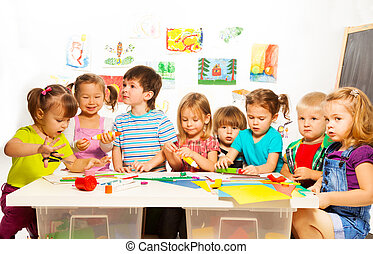 Many kids drawing and gluing - Large group of little kids...