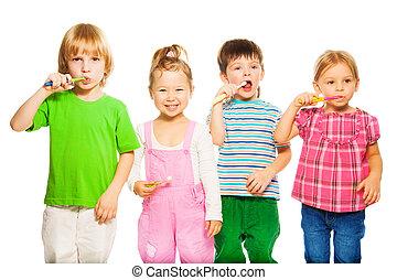 Four kids brushing teeth