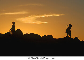 COUPLE SILHOUETTE at sunset - Romantic couple taking a...