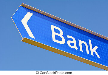 Bank street sign post with arrow isolated on blue sky...